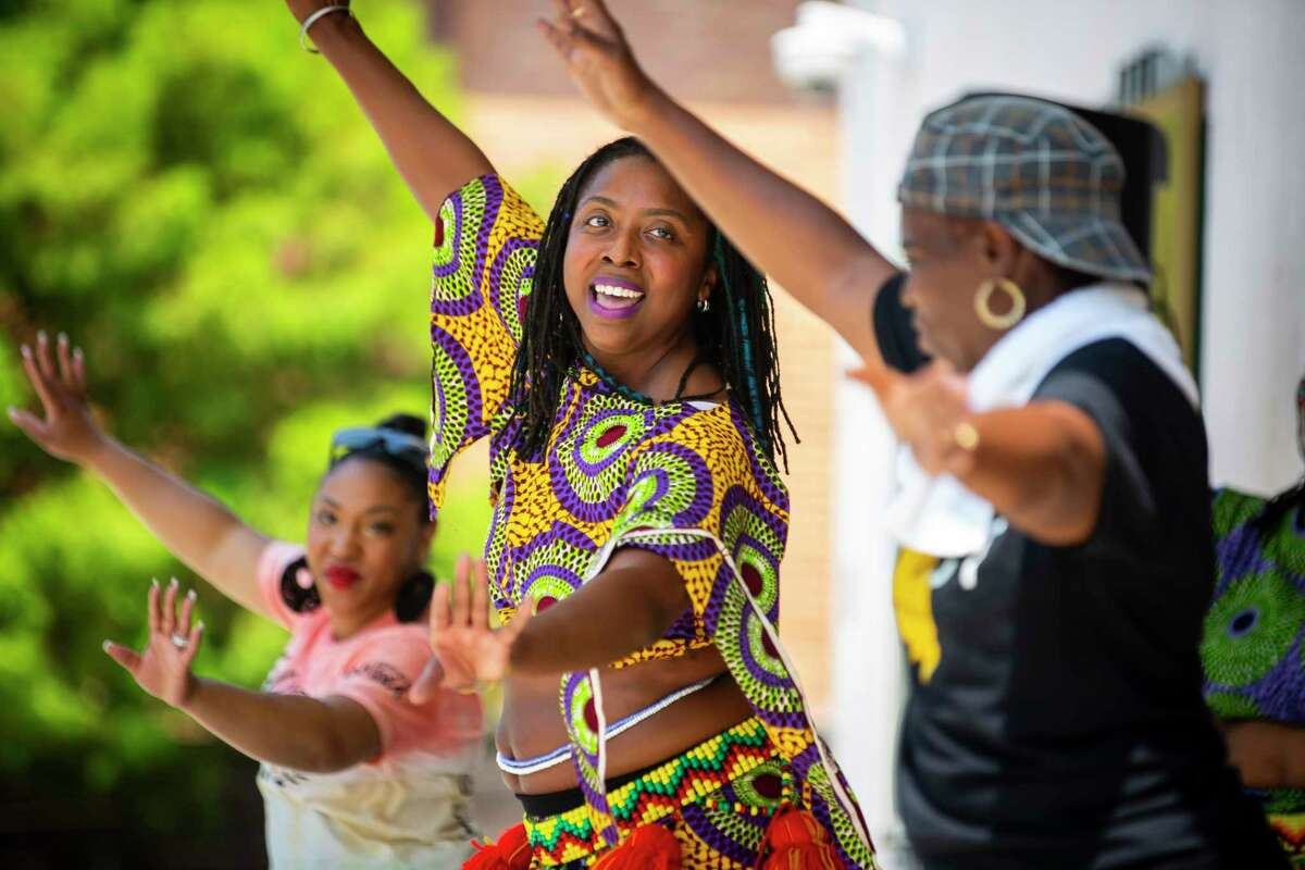 Alana Allen performs with KADDE, KoumanKele Africa Dance and Drum Ensemble, at a Juneteenth celebration at the historic DeLuxe Theater in Fifth Ward on Saturday, June 19, 2021.