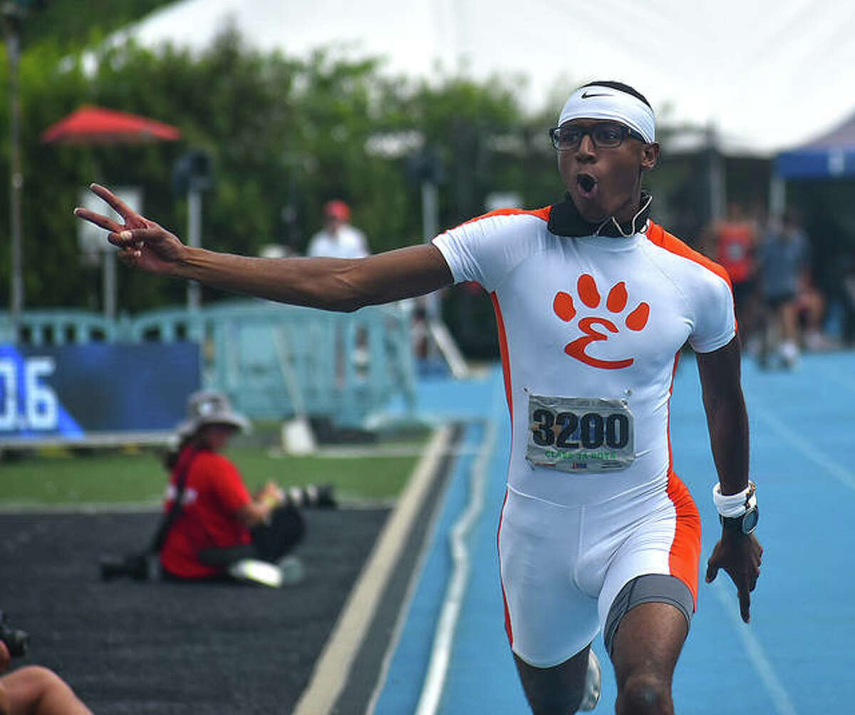 Edwardsville senior Brandon Battle celebrates after winning the 100-meter dash at the Class 3A boys state track and field meet on Saturday in Charleston.