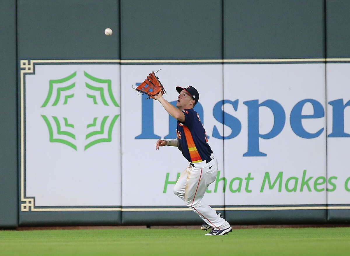 Houston Astros center fielder Myles Straw (3) catches a deep fly ball by Chicago White Sox catcher Yermin Mercedes (73) during the top eighth inning of the MLB game Saturday, June 19, 2021, at Minute Maid Park in Houston.