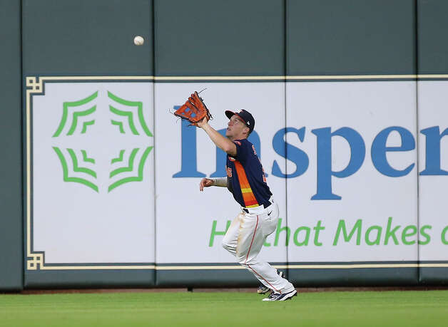 Houston Astros center fielder Myles Straw (3) catches a deep fly ball by Chicago White Sox catcher Yermin Mercedes (73) during the top eighth inning of the MLB game Saturday, June 19, 2021, at Minute Maid Park in Houston. Photo: Yi-Chin Lee/Staff Photographer / © 2021 Houston Chronicle