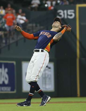 Houston Astros shortstop Carlos Correa (1) catches a pop-up by Chicago White Sox first baseman Andrew Vaughn (25) and ends top eighth inning of the MLB game Saturday, June 19, 2021, at Minute Maid Park in Houston. Photo: Yi-Chin Lee/Staff Photographer / © 2021 Houston Chronicle