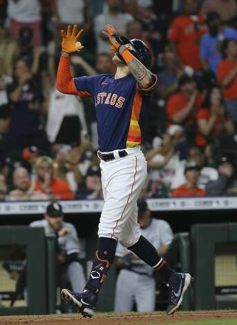 Houston Astros shortstop Carlos Correa (1) celebrates his solo home run from Chicago White Sox relief pitcher Jose Ruiz (66) during the bottom eighth inning of the MLB game Saturday, June 19, 2021, at Minute Maid Park in Houston. Photo: Yi-Chin Lee/Staff Photographer / © 2021 Houston Chronicle