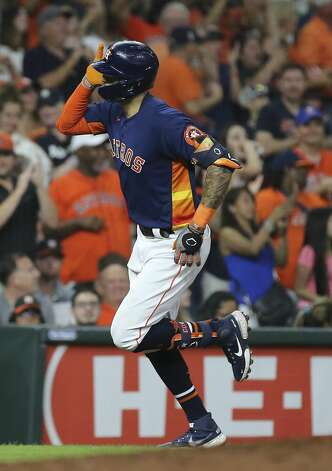 Houston Astros shortstop Carlos Correa (1) hits a solo home run from Chicago White Sox relief pitcher Jose Ruiz (66) during the bottom eighth inning of the MLB game Saturday, June 19, 2021, at Minute Maid Park in Houston. Photo: Yi-Chin Lee/Staff Photographer / © 2021 Houston Chronicle