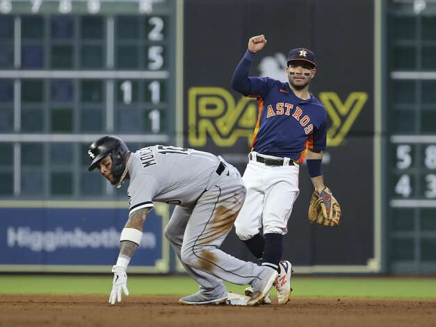 Houston Astros second baseman Jose Altuve (27) outs Chicago White Sox third baseman Yoan Moncada (10) at second base during the top sixth inning of the MLB game Saturday, June 19, 2021, at Minute Maid Park in Houston. Photo: Yi-Chin Lee/Staff Photographer / © 2021 Houston Chronicle