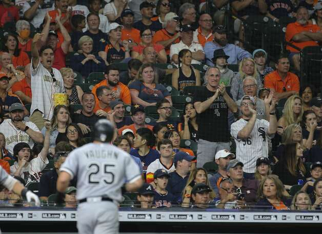 Houston Astros and Chicago White Sox fans react to Chicago White Sox first baseman Andrew Vaughn's single home run during the top seventh inning of the MLB game Saturday, June 19, 2021, at Minute Maid Park in Houston. Photo: Yi-Chin Lee/Staff Photographer / © 2021 Houston Chronicle