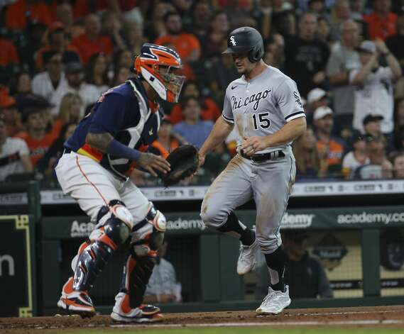 Chicago White Sox left fielder Adam Engel (15) scores with a double by Yoan Moncada during the top third inning of the MLB game against the Houston Astros Saturday, June 19, 2021, at Minute Maid Park in Houston. Photo: Yi-Chin Lee/Staff Photographer / © 2021 Houston Chronicle