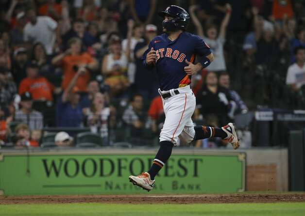 Houston Astros second baseman Jose Altuve (27) scores with a single by Michael Brantley during the bottom third inning of the MLB game against the Chicago White Sox Saturday, June 19, 2021, at Minute Maid Park in Houston. Photo: Yi-Chin Lee/Staff Photographer / © 2021 Houston Chronicle