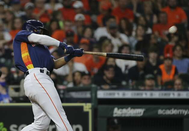 Houston Astros third baseman Robel Garcia (9) hits a double that clears a loaded base during the bottom third inning of the MLB game against the Chicago White Sox Saturday, June 19, 2021, at Minute Maid Park in Houston. Photo: Yi-Chin Lee/Staff Photographer / © 2021 Houston Chronicle