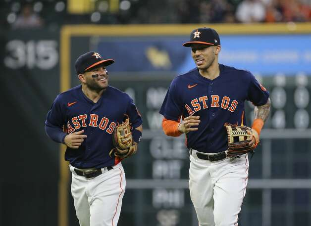 Houston Astros players Jose Altuve (27) and Carlos Correa (1) smile while talking between the fourth inning of the MLB game against the Chicago White Sox Saturday, June 19, 2021, at Minute Maid Park in Houston. Photo: Yi-Chin Lee/Staff Photographer / © 2021 Houston Chronicle