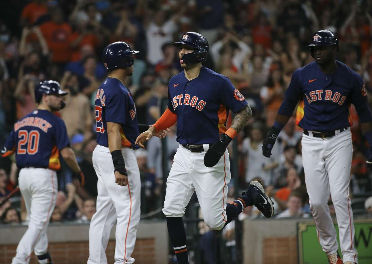 Houston Astros shortstop Carlos Correa (1), Michael Brantley, and Yordan Alvarez score with a double by Robel Garcia during the bottom third inning of the MLB game against the Chicago White Sox Saturday, June 19, 2021, at Minute Maid Park in Houston.
