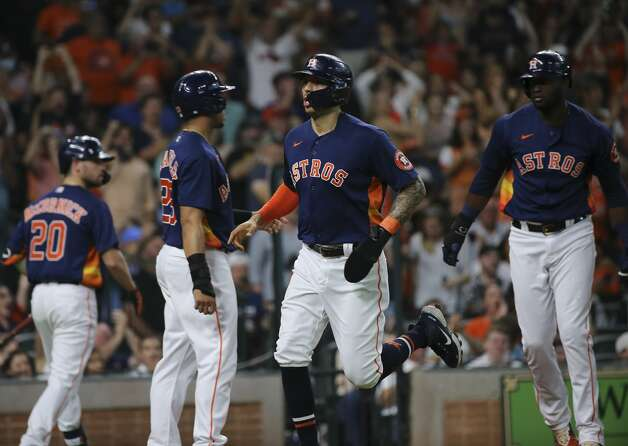 Houston Astros shortstop Carlos Correa (1), Michael Brantley, and Yordan Alvarez score with a double by Robel Garcia during the bottom third inning of the MLB game against the Chicago White Sox Saturday, June 19, 2021, at Minute Maid Park in Houston. Photo: Yi-Chin Lee/Staff Photographer / © 2021 Houston Chronicle