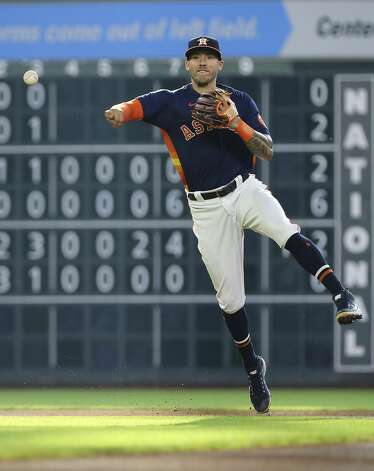 Houston Astros shortstop Carlos Correa (1) throws to first base to out Chicago White Sox third baseman Yoan Moncada (10) during the top first inning of the MLB game Saturday, June 19, 2021, at Minute Maid Park in Houston. Photo: Yi-Chin Lee/Staff Photographer / © 2021 Houston Chronicle