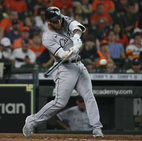 Chicago White Sox third baseman Yoan Moncada (10) hits a double and drives in one run during the top third inning of the MLB game against the Houston Astros Saturday, June 19, 2021, at Minute Maid Park in Houston. Photo: Yi-Chin Lee/Staff Photographer / © 2021 Houston Chronicle