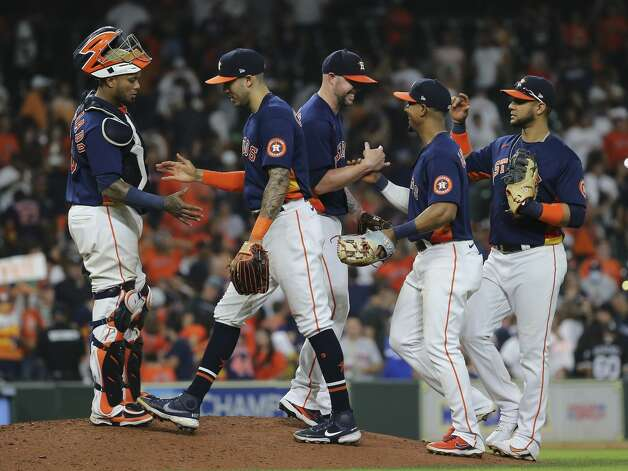 Houston Astros players celebrate the team's 7-3 win over Chicago White Sox in a MLB game Saturday, June 19, 2021, at Minute Maid Park in Houston. Photo: Yi-Chin Lee/Staff Photographer / © 2021 Houston Chronicle