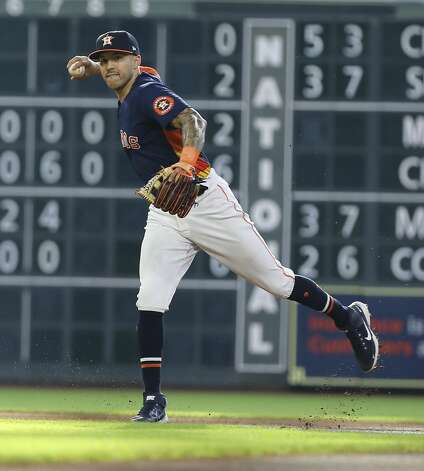 Houston Astros shortstop Carlos Correa (1) throws to first base during the top first inning of the MLB game against the Chicago White Sox Saturday, June 19, 2021, at Minute Maid Park in Houston. Photo: Yi-Chin Lee/Staff Photographer / © 2021 Houston Chronicle