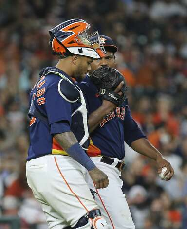 Houston Astros catcher Martin Maldonado (15) talks to starting pitcher Framber Valdez (59) during the top sixth inning of the MLB game Saturday, June 19, 2021, at Minute Maid Park in Houston. Photo: Yi-Chin Lee/Staff Photographer / © 2021 Houston Chronicle