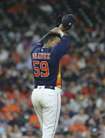Houston Astros starting pitcher Framber Valdez (59) wipes away sweat while pitching the top sixth inning of the MLB game against the Chicago White Sox Saturday, June 19, 2021, at Minute Maid Park in Houston. Photo: Yi-Chin Lee/Staff Photographer / © 2021 Houston Chronicle