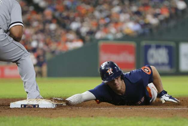 Houston Astros center fielder Myles Straw (3) slides back to first base during the bottom sixth inning of the MLB game against the Chicago White Sox Saturday, June 19, 2021, at Minute Maid Park in Houston. Photo: Yi-Chin Lee/Staff Photographer / © 2021 Houston Chronicle