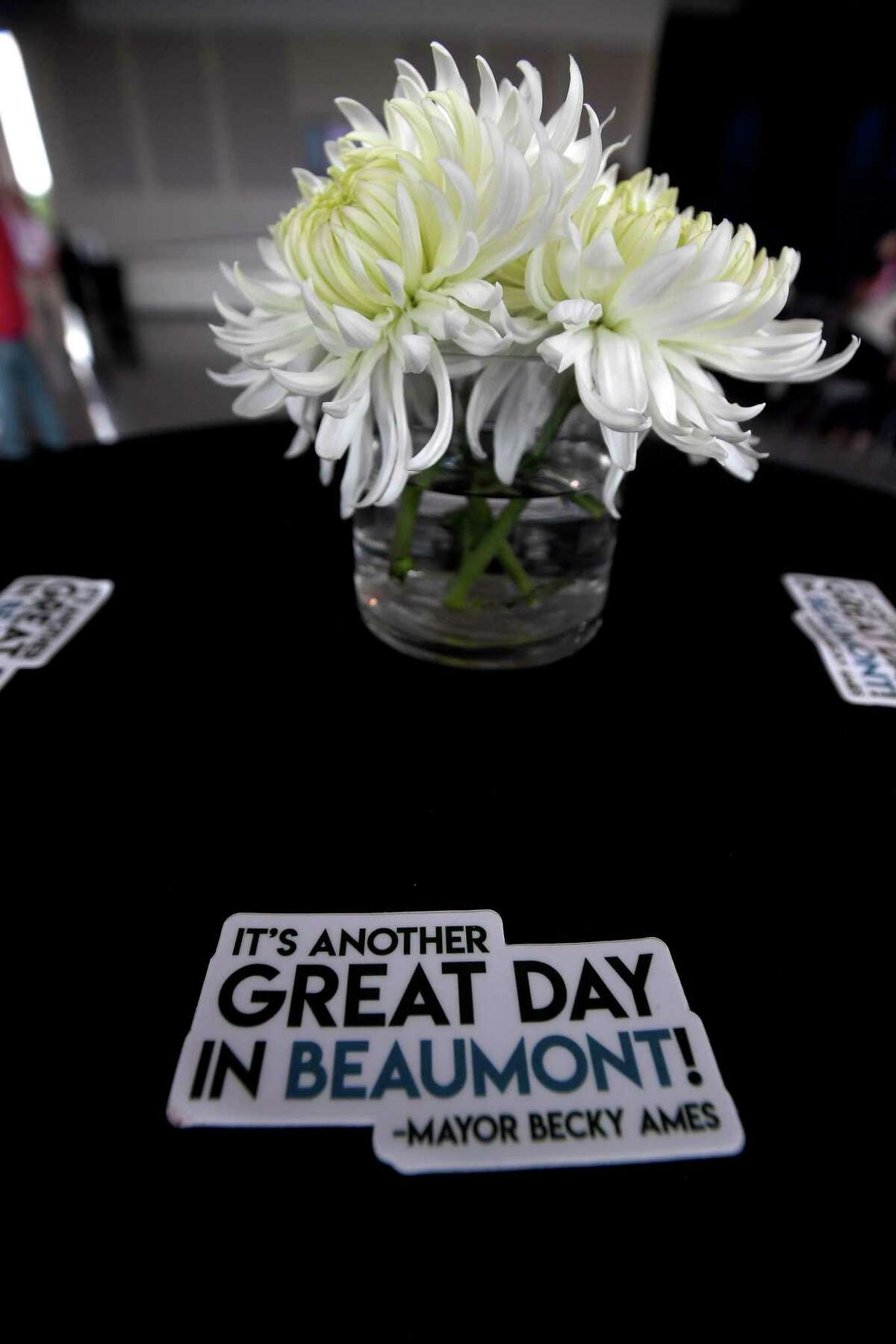 Mayor Becky Ames' signature phrase was amonng the table decorations during a farewell reception for Becky Ames - Beaumont's longest-serving mayor - Tuesday at the Event Centre. Photo made Tuesday, June 15, 2021 Kim Brent/The Enterprise