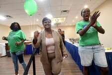 Robin Mouton celebrates with supporters, including her campaign manager Gwen Dalcour (right), at her watch party in Beaumont's mayoral run-off election Saturday. Photo made Saturday, June 19, 2021 Kim Brent/The Enterprise
