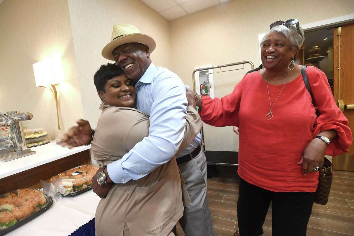 Robin Mouton gets a hug from her pastor Edison Colbert as he and wife Ava join in the celebration at her watch party in Beaumont's mayoral run-off election Saturday. Photo made Saturday, June 19, 2021 Kim Brent/The Enterprise