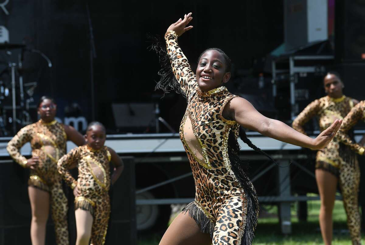 Miniya Bailey and members of Sensational Expressions majorette team of Beaumont perform during Beaumont's annual Juneteenth celebration in Tyrrell Park Saturday. Photo made Saturday, June 19, 2021 Kim Brent/The Enterprise