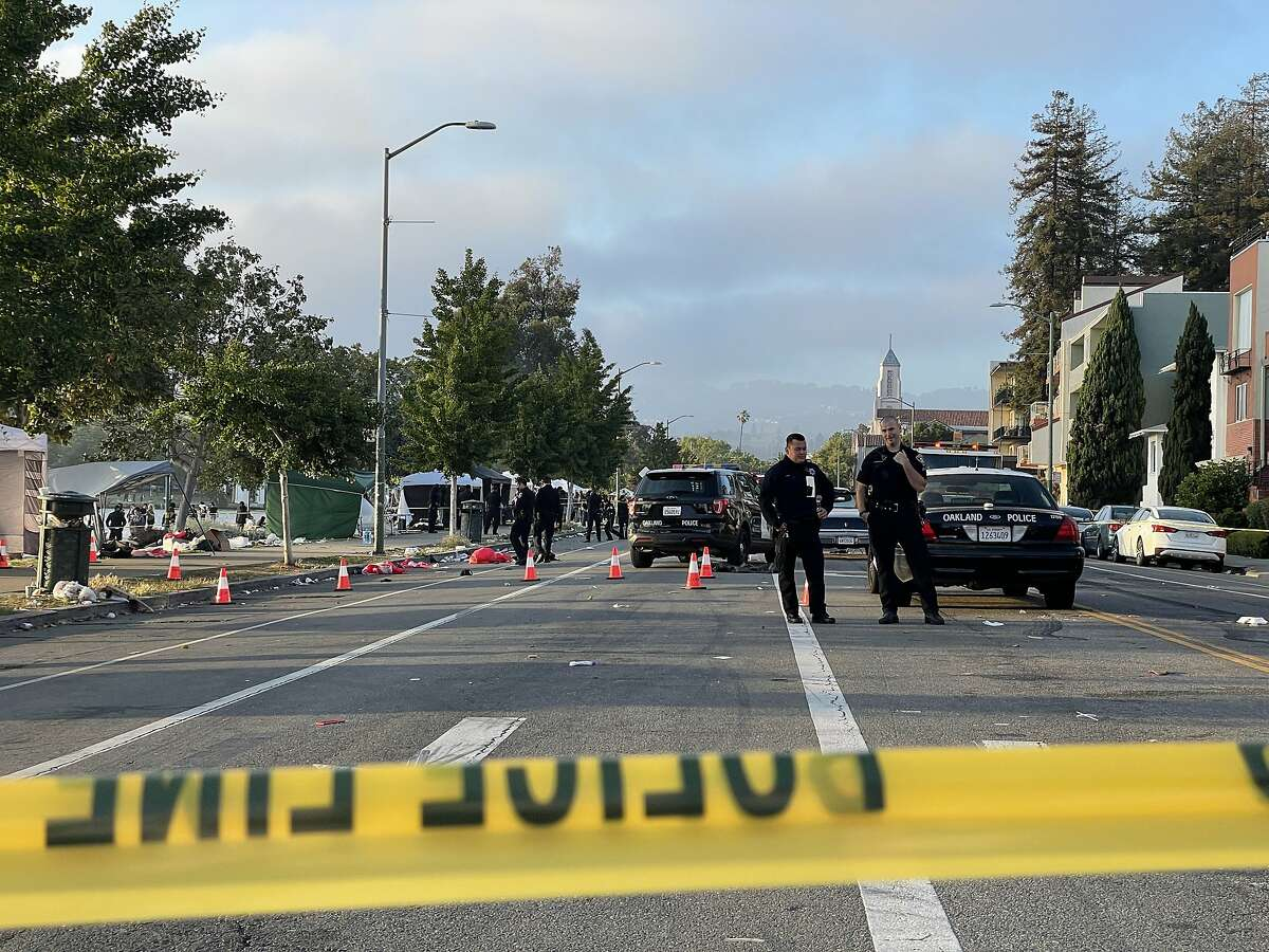 Police investigate the scene of a fatal shooting at Lakeshore and Brooklyn avenues in Oakland.