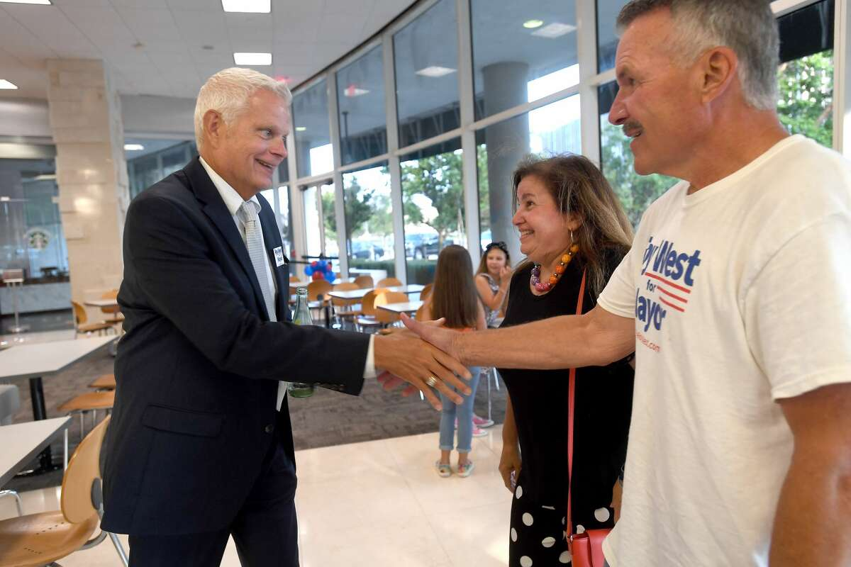 Roy West gathers with supporters, including Allison and Mike Getz at his watch party in Beaumont's mayoral run-off election Saturday. Photo made Saturday, June 19, 2021 Kim Brent/The Enterprise