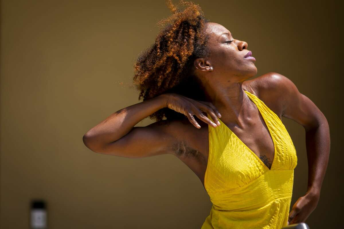 Courtney Sherman-Allen performs at Fifth Ward Cultural Arts District?•s first Juneteenth Community Arts Market & Celebration at the historic DeLuxe Theater in Fifth Ward on Saturday, June 19, 2021.