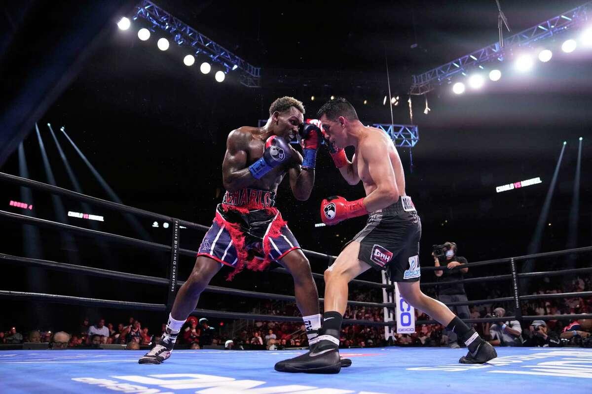 Jermall Charlo, left, fights Juan Macias Montiel during a WBC middleweight world championship boxing match Saturday, June 19, 2021, in Houston. Charlo won the fight. (AP Photo/David J. Phillip)