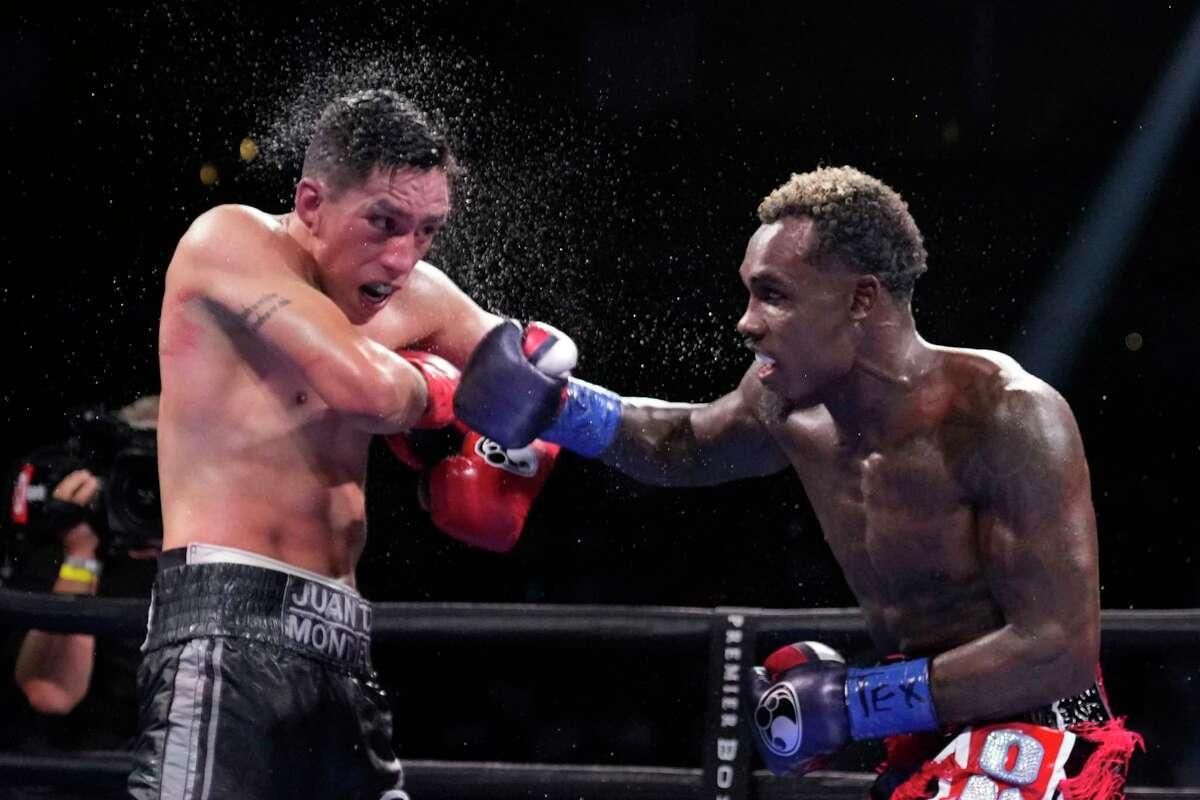 Jermall Charlo, right, hits Juan Macias Montiel during a WBC middleweight world championship boxing match Saturday, June 19, 2021, in Houston. Charlo won the fight. (AP Photo/David J. Phillip)