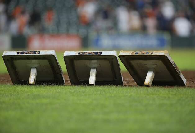 The Houston Astros bases are taken off the field after the MLB game against the Chicago White Sox Saturday, June 19, 2021, at Minute Maid Park in Houston. Photo: Yi-Chin Lee/Staff Photographer / © 2021 Houston Chronicle