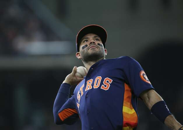 Houston Astros second baseman Jose Altuve (27) thros a ball to the fans between third inning of the MLB game Saturday, June 19, 2021, at Minute Maid Park in Houston. Photo: Yi-Chin Lee/Staff Photographer / © 2021 Houston Chronicle