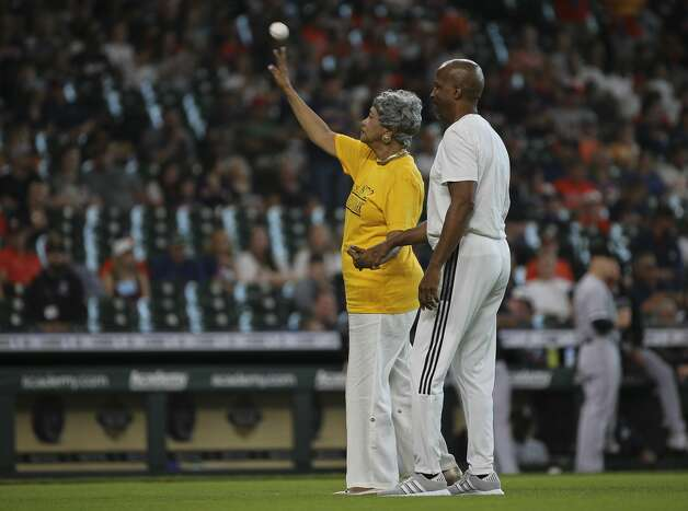 Jaqueline W. Bostic, Vice Chair of the Emancipation Park Conservancy Board of Directors, left, performs the first pitch of the MLB game between Houston Astros and Chicago White Sox to celebrate Juneteenth Saturday, June 19, 2021, at Minute Maid Park in Houston. Bostic was accompanied by son-in-law. Photo: Yi-Chin Lee/Staff Photographer / © 2021 Houston Chronicle