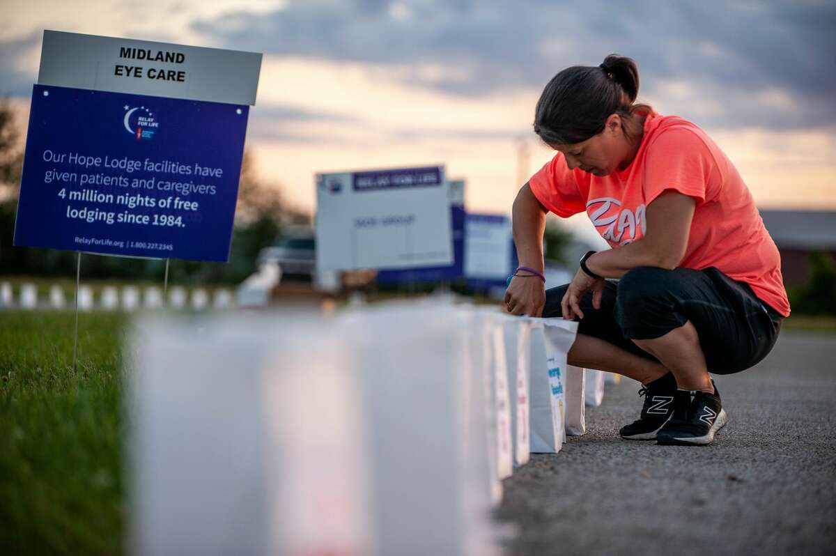 Midland resident Laura Wolanin lights candles for the Luminaria display during the 2021 Midland County Relay for Life on June 19, at the Midland County Fairgrounds (Photo by Andrew Mullin/amullin@hearstnp.com).