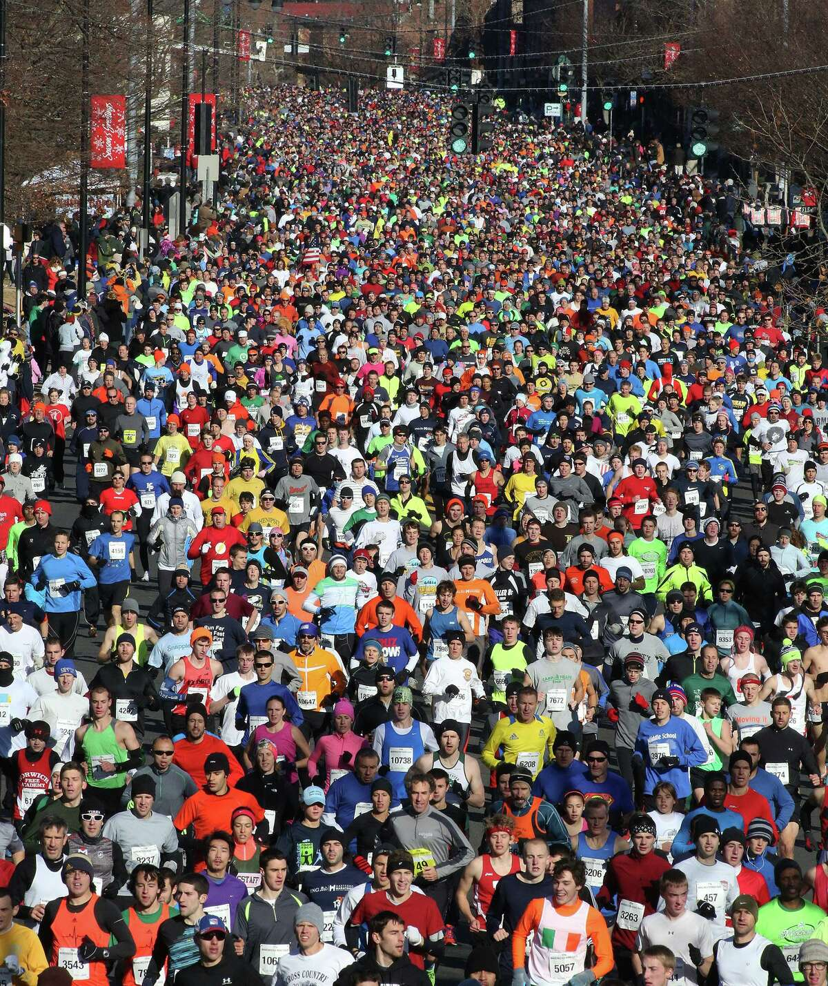 Around 15,000 runners participate in the 77th Annual Manchester Road Race, in Manchester, Conn., on Thursday, Nov. 28, 2013. (AP Photo/Journal Inquirer, Jared Ramsdell) Mandatory Credit