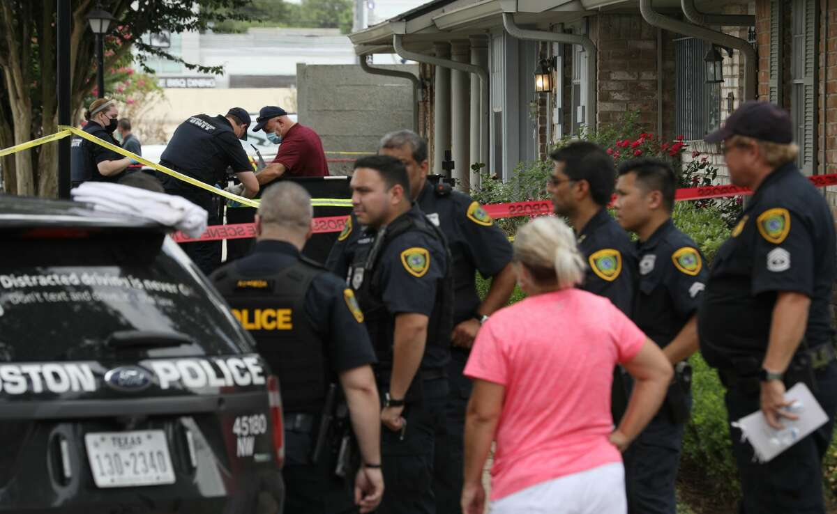 Authorities investigate the scene of a shooting that left two women dead Sunday, June 20, 2021, in Houston. Houston Police also said that the suspect fired at officers, and that officers fired back, striking the suspect.