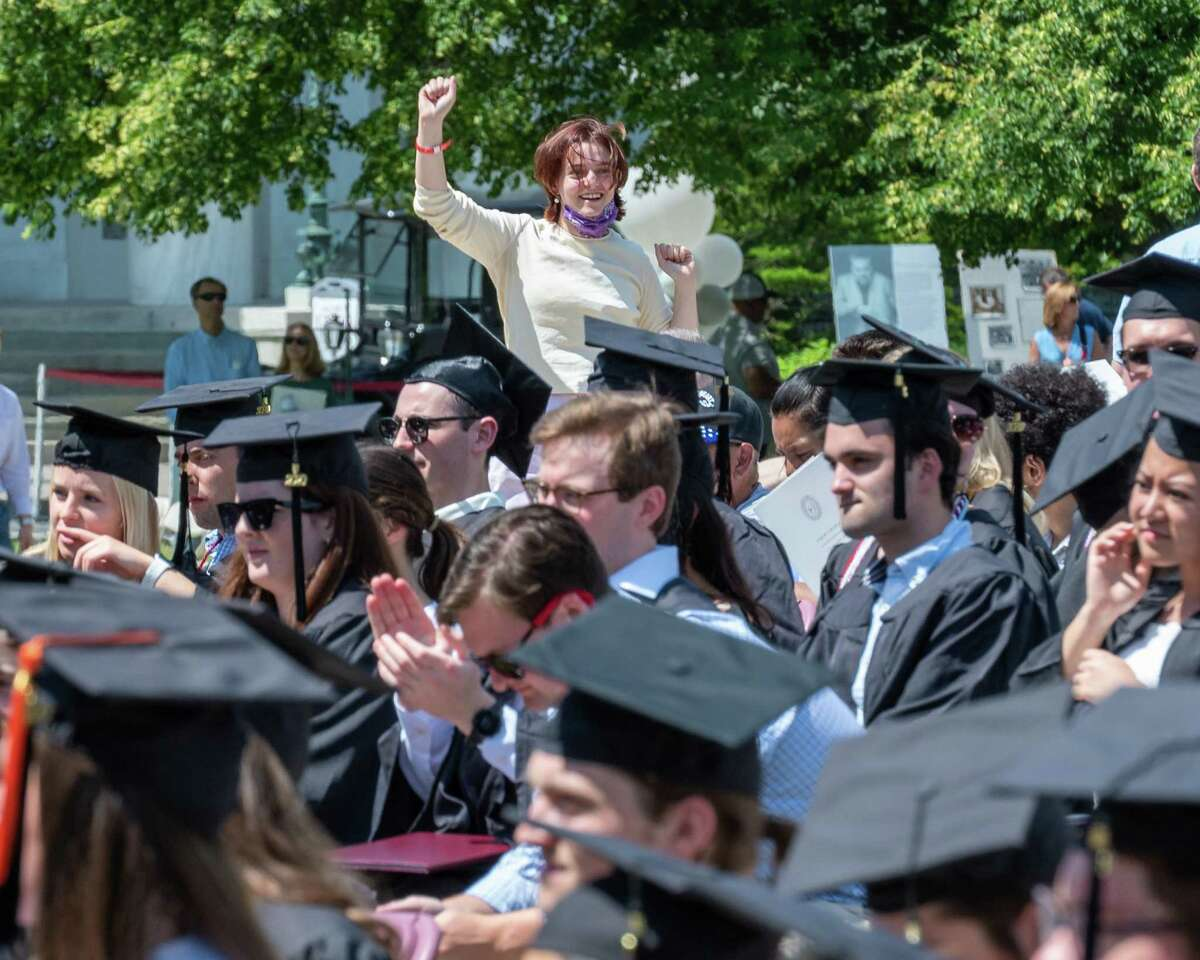 A woman cheers a 2020 Union College graduate during a commencement ceremony on Sunday, June 20, 2021. In person ceremonies were cancelled last year were canceled because COVID-19. About 330 graduates out of 477 graduates came back to the Schenectady, NY, campus to participate. (Jim Franco/Special to the Times Union)