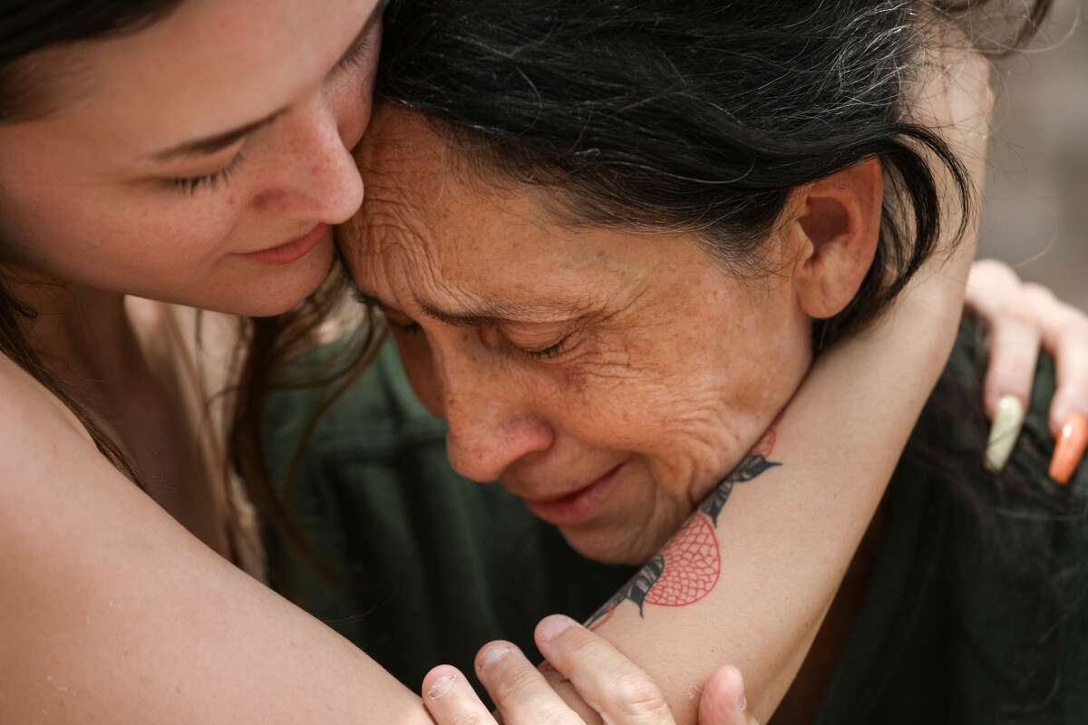 """Jeannette Lillard, right, is comforted by her daughter Mary at the scene of a shooting that left two family members dead Sunday, June 20, 2021, in the 1000 block of E. Tri Oaks in Houston. """"Virginia was a loving, wonderful girl,"""" Jeannette's husband George said of his niece who was killed. """"That was part of the problem, she just put up with too much."""" Jeannette Lillard's sister-in-law was also killed."""