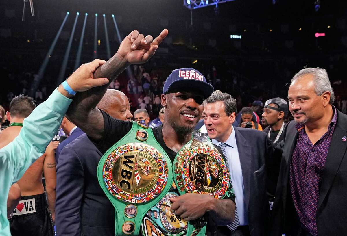 Jermall Charlo poses with his championship belts after beating Juan Macias Montiel in a WBC middleweight world championship boxing match Saturday, June 19, 2021, in Houston. (AP Photo/David J. Phillip)
