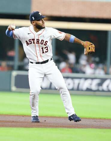 Houston Astros third baseman Abraham Toro (13) gets Chicago White Sox shortstop Tim Anderson (7) out at first in the first inning at Minute Maid Park in Houston on Sunday, June 20, 2021. Photo: Elizabeth Conley, Staff Photographer / © 2021 Houston Chronicle