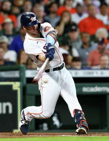 Houston Astros right fielder Chas McCormick (20) gets Ann infield hit in the fist inning against Chicago White Sox at Minute Maid Park in Houston on Sunday, June 20, 2021. Photo: Elizabeth Conley, Staff Photographer / © 2021 Houston Chronicle