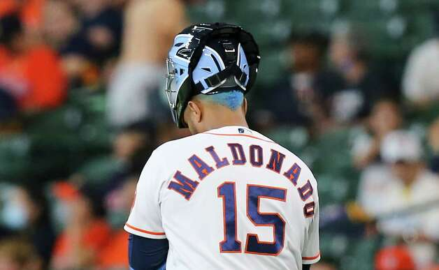 Houston Astros catcher Martin Maldonado (15) shows off a new hair color before going to warm up before the Houston Astros take on the Chicago White Sox at Minute Maid Park in Houston on Sunday, June 20, 2021. Photo: Elizabeth Conley, Staff Photographer / © 2021 Houston Chronicle