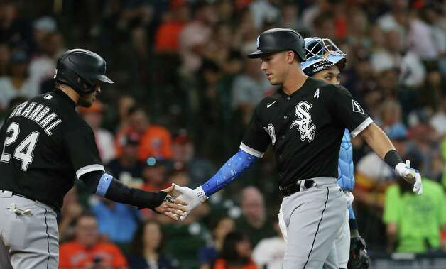 Chicago White Sox third baseman Jake Lamb (23) is congratulated by Chicago White Sox catcher Yasmani Grandal (24) after hitting a 2-run home run in the second inning against Houston Astros at Minute Maid Park in Houston on Sunday, June 20, 2021. Photo: Elizabeth Conley, Staff Photographer / © 2021 Houston Chronicle