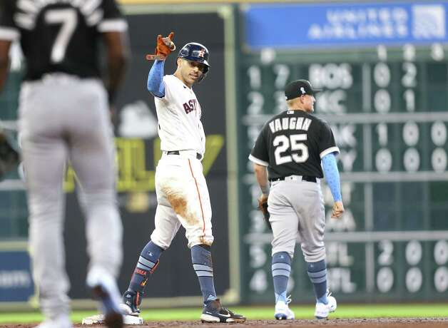 Houston Astros shortstop Carlos Correa (1) reacts after making it to second base after an error during  a rundown against Chicago White Sox in the third inning at Minute Maid Park in Houston on Sunday, June 20, 2021. Photo: Elizabeth Conley, Staff Photographer / © 2021 Houston Chronicle