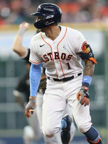 Houston Astros shortstop Carlos Correa (1) gets caught in a rundown between first and second base after hitting a single in the third  inning against Chicago White Sox  at Minute Maid Park in Houston on Sunday, June 20, 2021. Photo: Elizabeth Conley, Staff Photographer / © 2021 Houston Chronicle