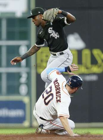 Chicago White Sox shortstop Tim Anderson (7) hops over Houston Astros right fielder Chas McCormick (20) in na forced out to end the third inning at Minute Maid Park in Houston on Sunday, June 20, 2021. Photo: Elizabeth Conley, Staff Photographer / © 2021 Houston Chronicle