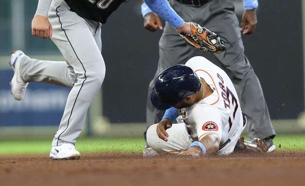 Houston Astros third baseman Abraham Toro (13) is caught stilling second by Chicago White Sox second baseman Danny Mendick (20) in the fourth inning at Minute Maid Park in Houston on Sunday, June 20, 2021. Photo: Elizabeth Conley, Staff Photographer / © 2021 Houston Chronicle