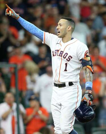 Houston Astros shortstop Carlos Correa (1) points to the stands after scoring a solo home run against Chicago White Sox in the fourth inning at Minute Maid Park in Houston on Sunday, June 20, 2021. Photo: Elizabeth Conley, Staff Photographer / © 2021 Houston Chronicle