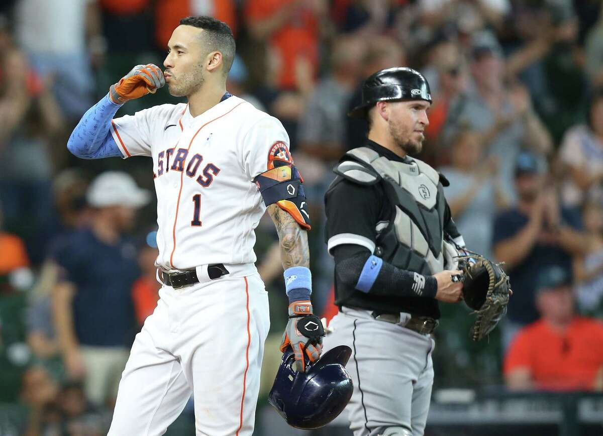 Houston Astros shortstop Carlos Correa (1) blows a kiss into the stands after running is a solo home run against Chicago White Sox in the fourth inning at Minute Maid Park in Houston on Sunday, June 20, 2021.